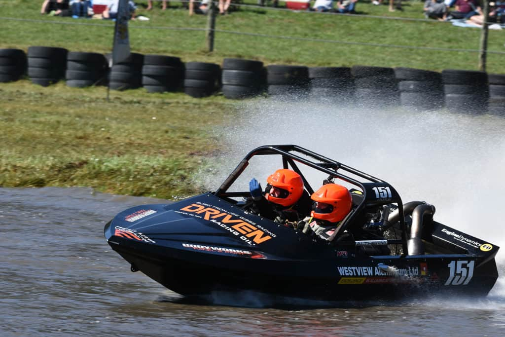 jet sprint racer putting Sprintec jet boat through its paces